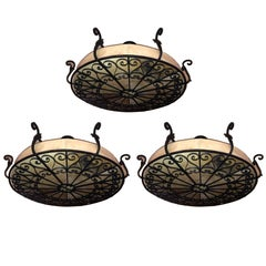 Pair of Wrought Iron and Parchment Fixtures