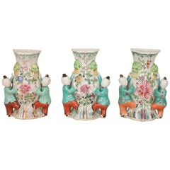 Set of Three Chinese Porcelain Famille Rose Wall Vases, Boys, 18th Century