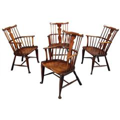 Harlequin Set of Four Comb-Back Windsor Armchairs
