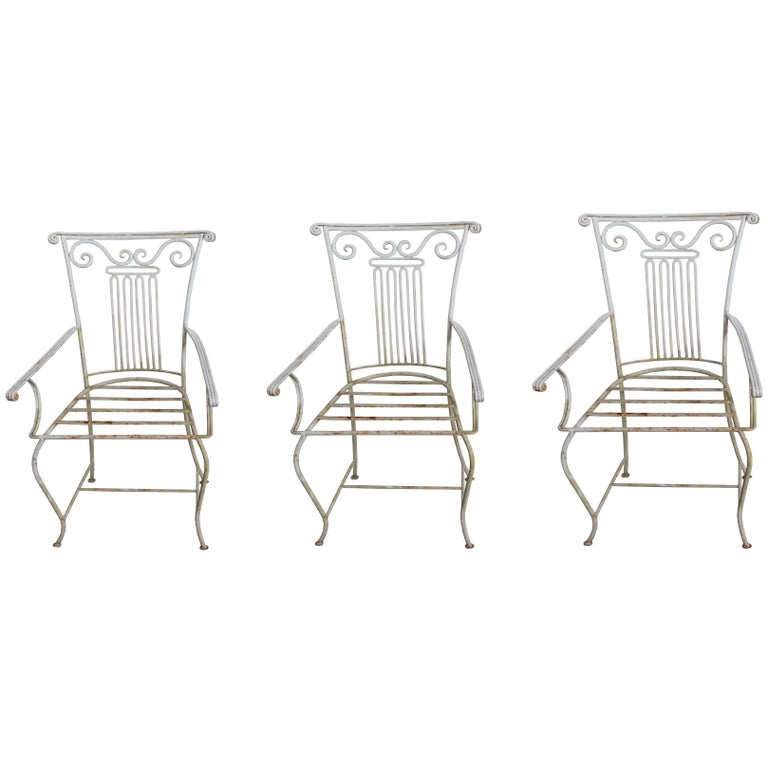 Set of Three Neoclassical Wrought Iron Garden Chairs sold individually For Sale
