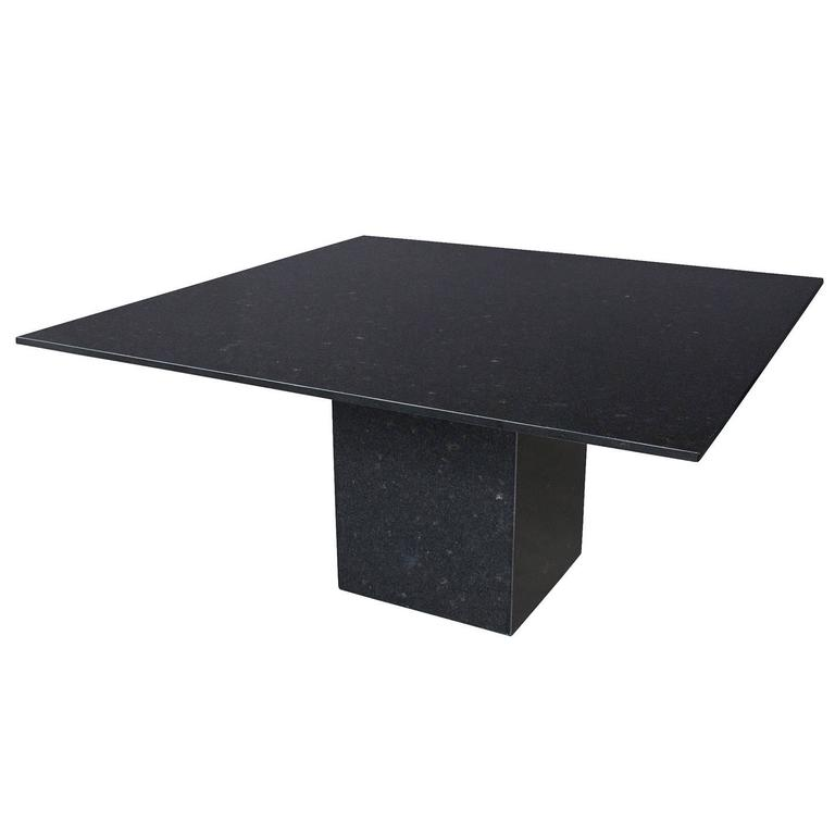 this minimalist italian black granite pedestal dining table is no