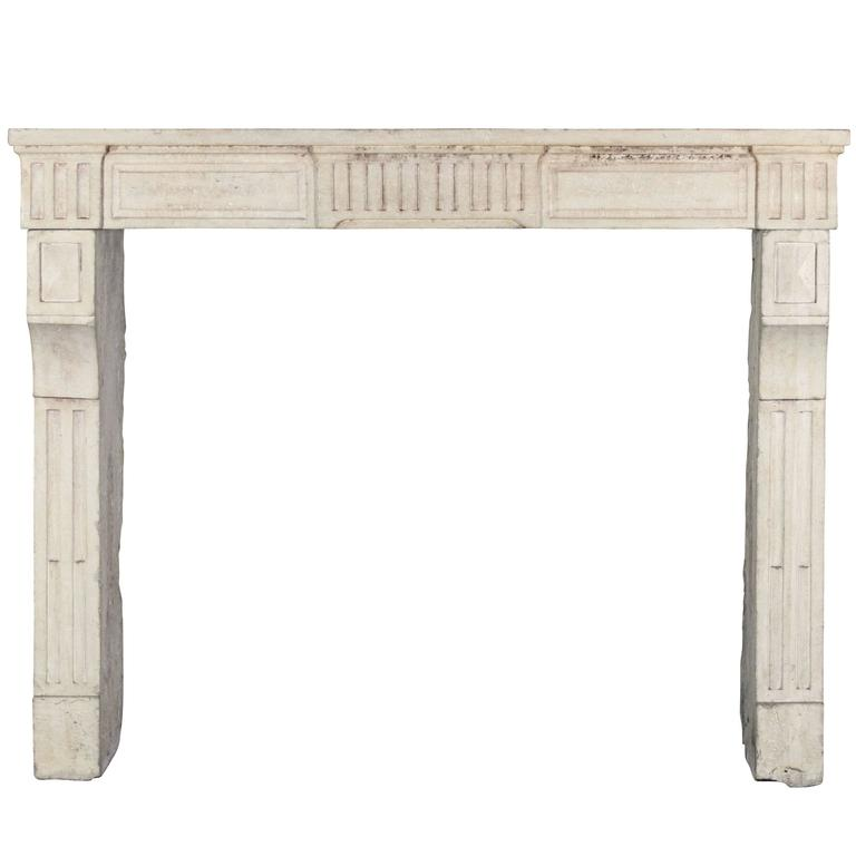 18th Century, Limestone antique fireplace mantel from the LXVI period.