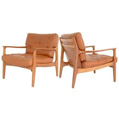 PAIR OF COGNAC LEATHER easy CHAIRS