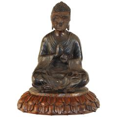 Cast Bronze Temple Figure on Carved Walnut Lotus Leaf Base