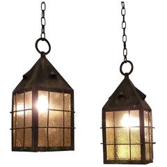1920s Pair of Arts and Crafts Copper Lantern Pendant Lights with Amber Glass