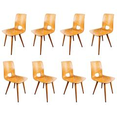Eight Chairs by Hans Bellmann
