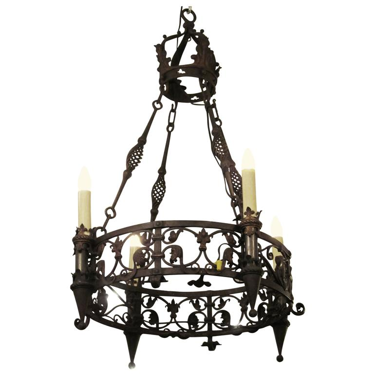 1920s Wrought Iron Four Light Chandelier With Spirals And Hand Tooled Designs For