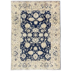 Unique Turkish Oushak Rug with Floral Design in Dark Blue, Cream and Light Brown