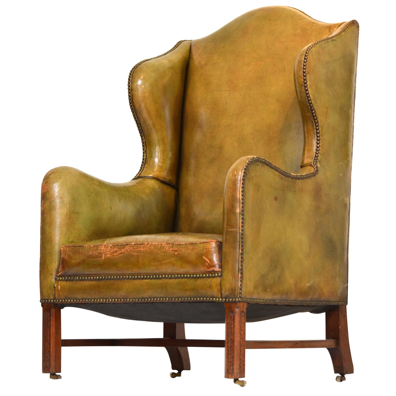 Vintage Green Leather Wing Chair For Sale at 1stdibs