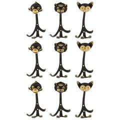 Nine Walter Bosse Coat Wall Hooks Brass, Monkey Lion Cat, Austria, 1950s