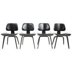 Set of Four Early DCW Chairs by Eames for Evans Products