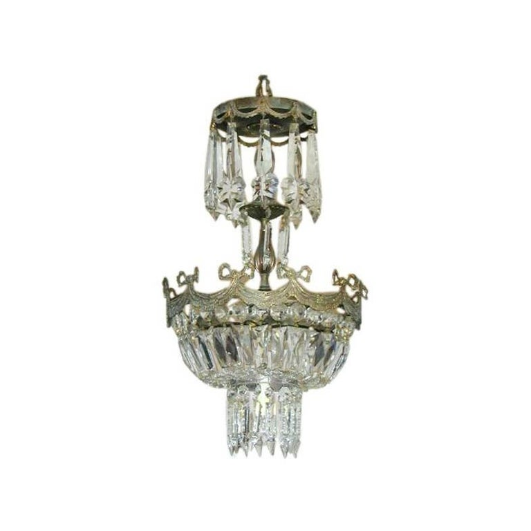 French Mid Century Modern Neoclassical Crystal And Silvered Bronze Chandelier For