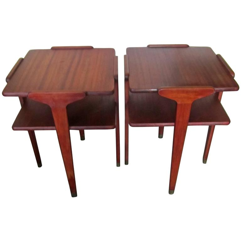 A beautiful and very well made pair of wood end tables or night stand [nightstand] tables, with shelf and sleek leg design from top to bottom, including brass accent at base.