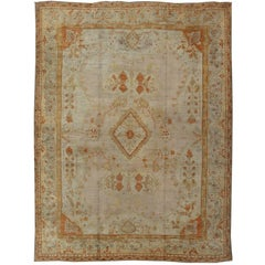 Antique Turkish Oushak Rug in green, Yellow, blush, apricot and light blue