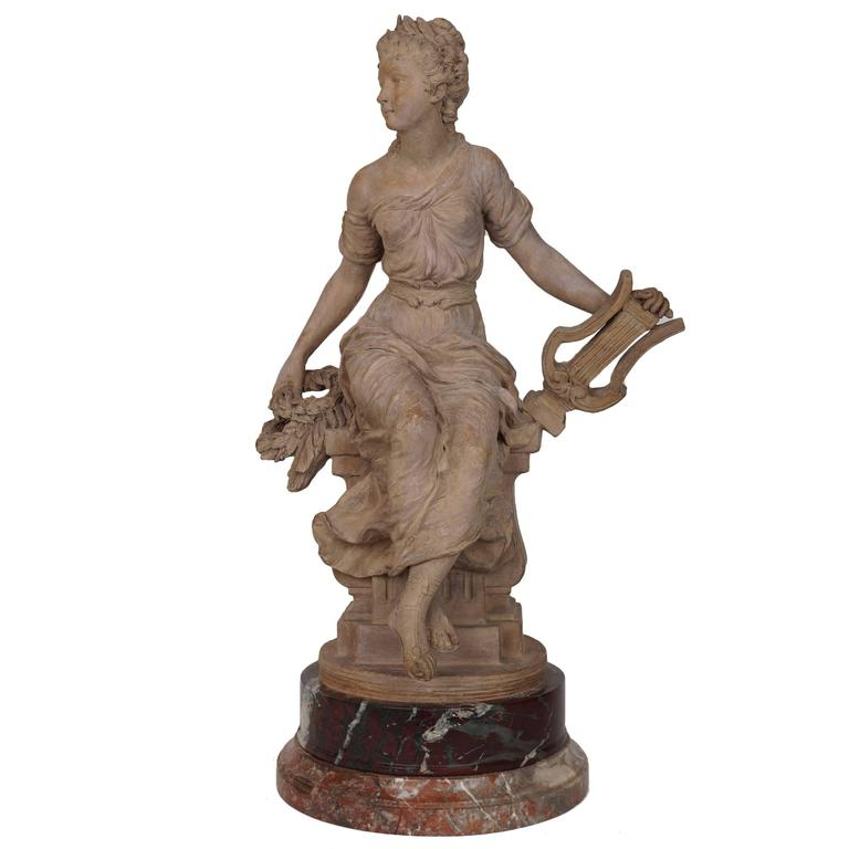 Fine Terracotta Figure of a Seated Woman Holding Musical Instrument