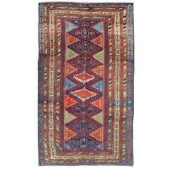 Antique Kurdish Kazak with Tribal and Geometric Motifs