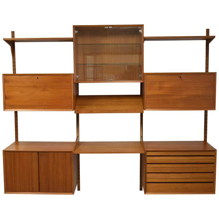mid century modern adjustable wall shelving unit at 1stdibs. Black Bedroom Furniture Sets. Home Design Ideas