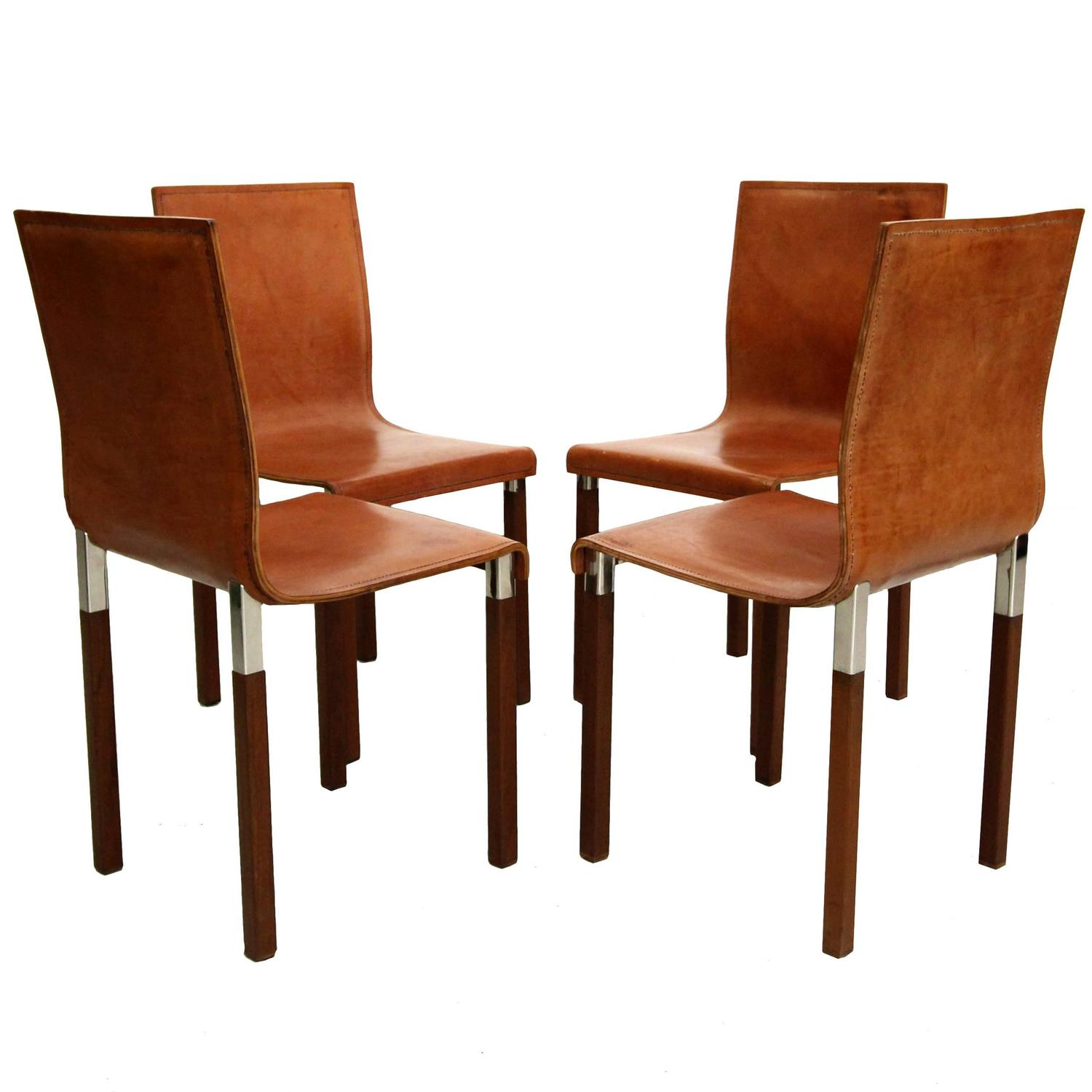 Set of four leather emile industrial modern dining chairs for Modern leather dining room chairs