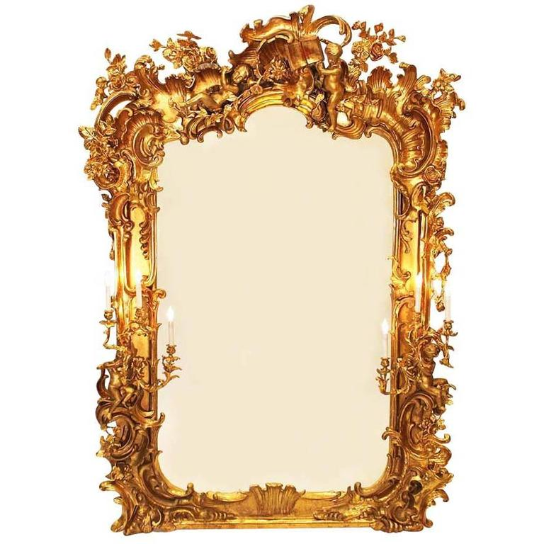 Monumental Italian 19th Century Baroque Giltwood and Gesso Carved Figural Mirror For Sale