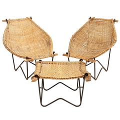 "Pair of John Risley Rattan ""Duyan"" Lounge Chairs and Ottoman"