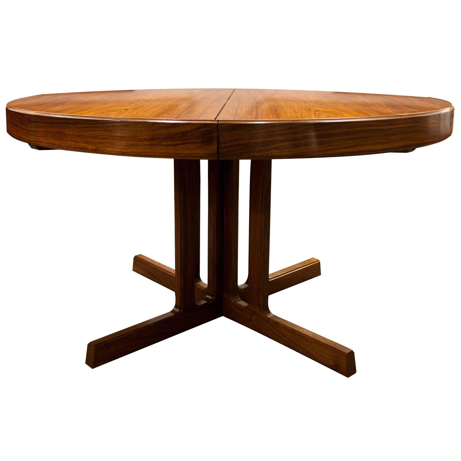 Mid century modern design rosewood dining table at 1stdibs for Mid century modern dining table