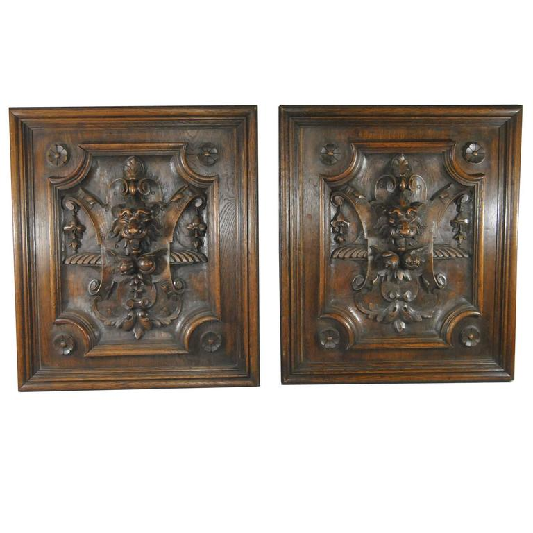 Tudor style high relief carved oak panels with lions heads