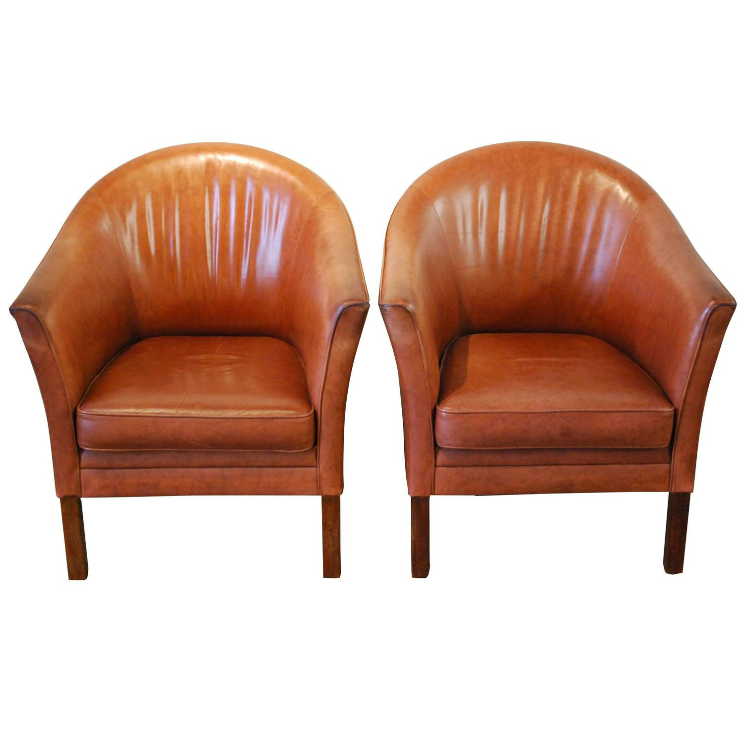 pair of mid century club chairs in full grain leather at 1stdibs