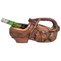 Early 20th Century French Carved Walnut Clog Wine Bottle Holder with Vine Decor