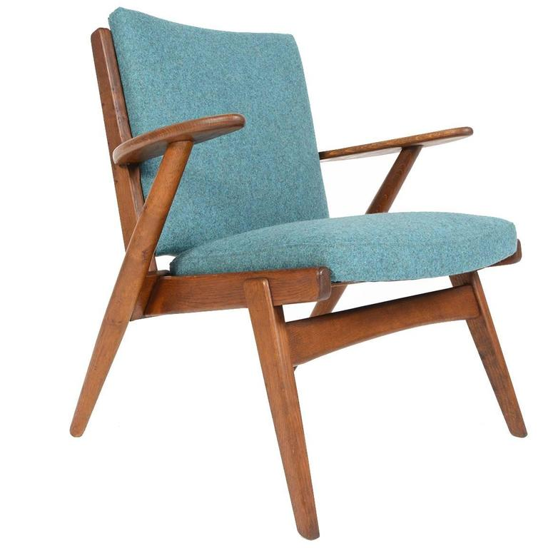 Paddle Arm Lounge Chair in Stained Oak For Sale