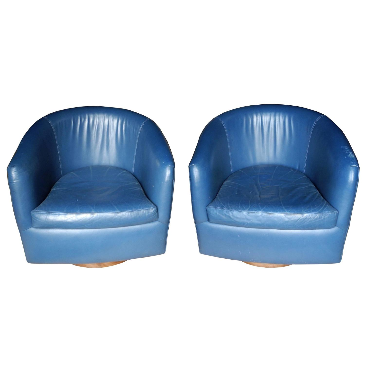 Pair of mid century modern blue leather swivel lounge chairs by milo