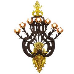 Large French Art Deco Patinated and Gilt Bronze Seven-Light Figural Wall Sconce