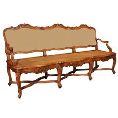 19th Century French Louis XV Carved Walnut Settee with Seat and Back Cane