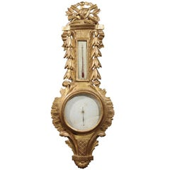 French Mid 19th Century Louis XVI Style Giltwood Barometer with Carved Crest