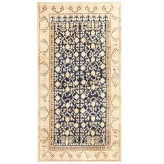 Small Pomegranate Design Antique Khotan Rug