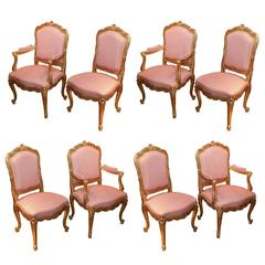Set of Eight French Louis XV Style Giltwood Dining Chairs, highly carved