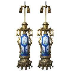 Pair of French Porcelain Urn Lamps with Finely Detailed Ormolu Mounts, 1800s