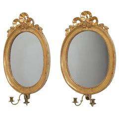 Pair of Swedish Oval Giltwood Mirrors, circa 1760
