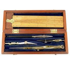 Small Mahogany Box Containing Compasses and Proportional Compasses