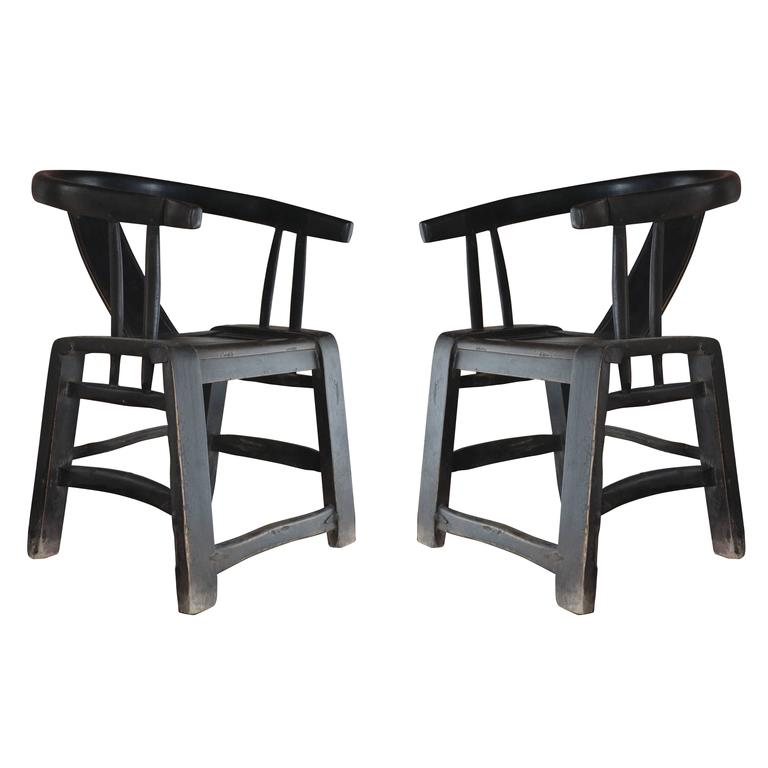 Pair of unique Horseshoe-back Chinese Wooden Chairs 1
