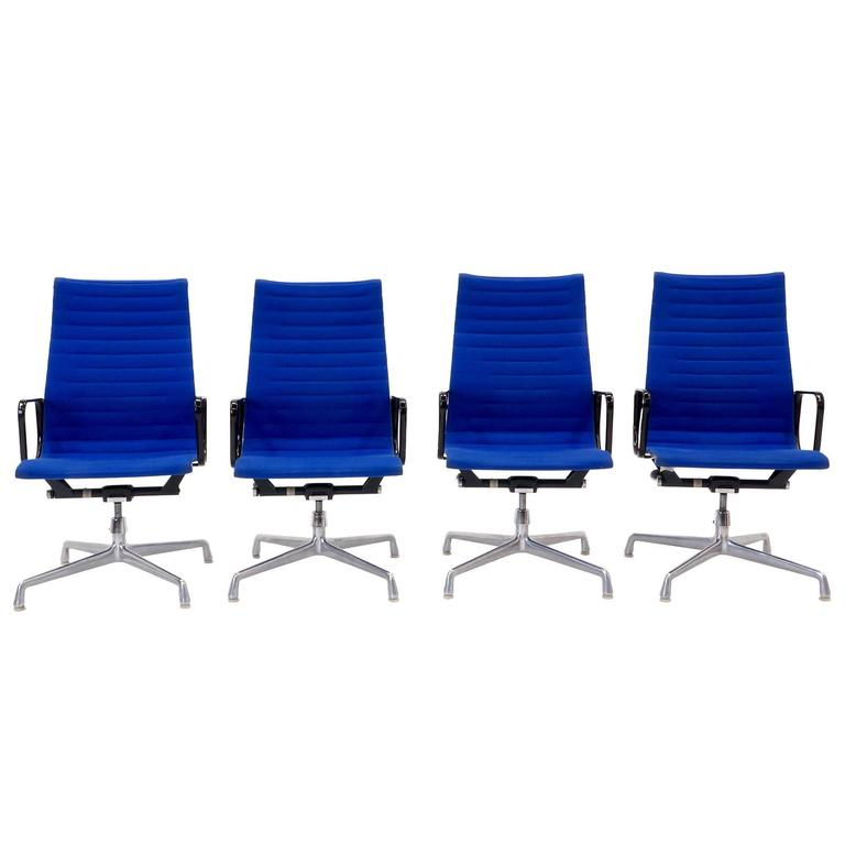 Charles and Ray Eames High Back Aluminum Group Chairs in Original Blue Fabric