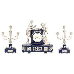 Silvered Bronze and Lapis Lazuli Three-Piece Clock Set