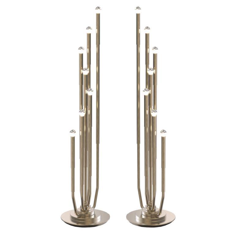 pair of delightful stardust gold brass revolving modern floor lamps 1