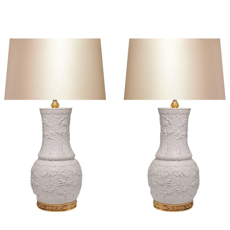 Pair of Fine Carved White Porcelain Lamps For Sale