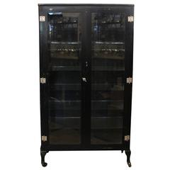 1920s Vintage Black Medical Cabinet with Glass Shelves and Beveled Glass Doors