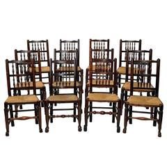A Harlequin set of 12 Georgian Oak and Elm Spindle Back Chairs, circa 1820