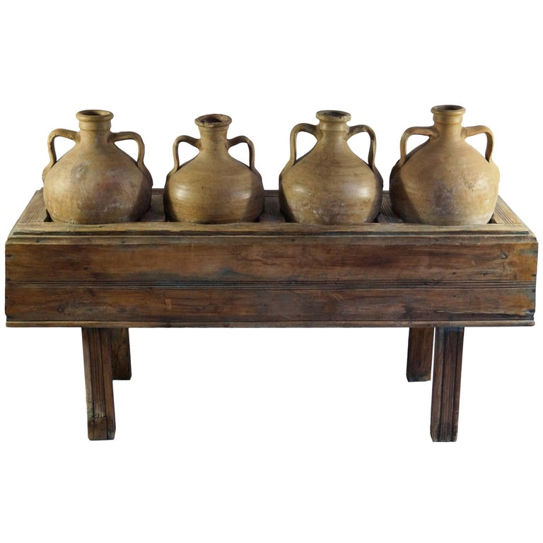 Late 19th Century Italian Table with Four Olive Oil Jars For Sale
