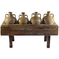 Late 19th Century Italian Table with Four Olive Oil Jars