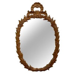 French Louis XV Style Oval Carved Wood Mirror with Foliage Motifs