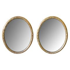 Elegant Pair of French Napoleon III Carved Giltwood Oval Mirrors