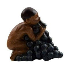 Bing & Grondahl, Stoneware Figurine of Boy with Bunch of Grapes by Kai Nielsen